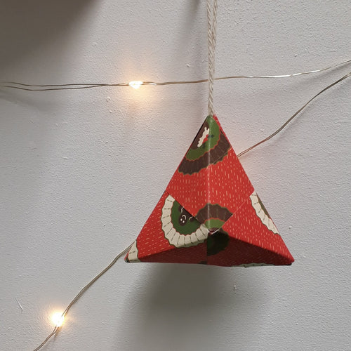 Small pyramid shaped red handmade origami Christmas bauble