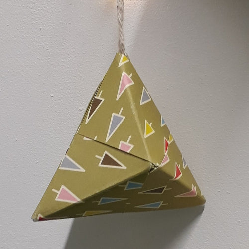 Small pyramid shaped green handmade origami Christmas bauble