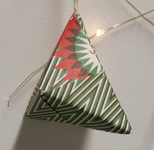 Small pyramid shaped green and white striped handmade origami Christmas bauble