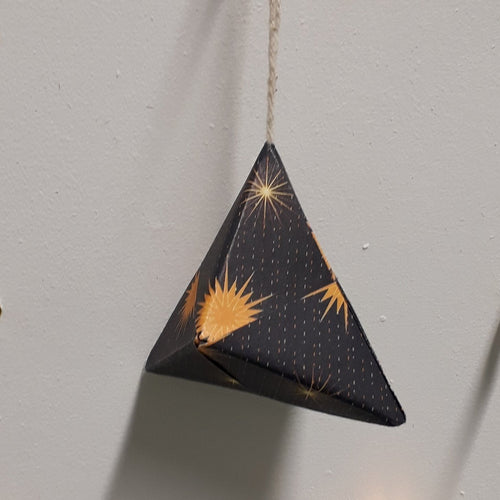Small pyramid shaped navy and gold handmade origami Christmas bauble