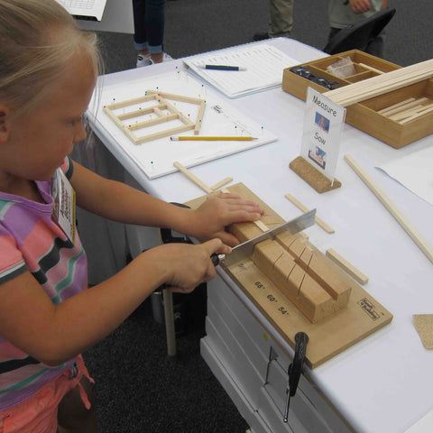 students measure and saw