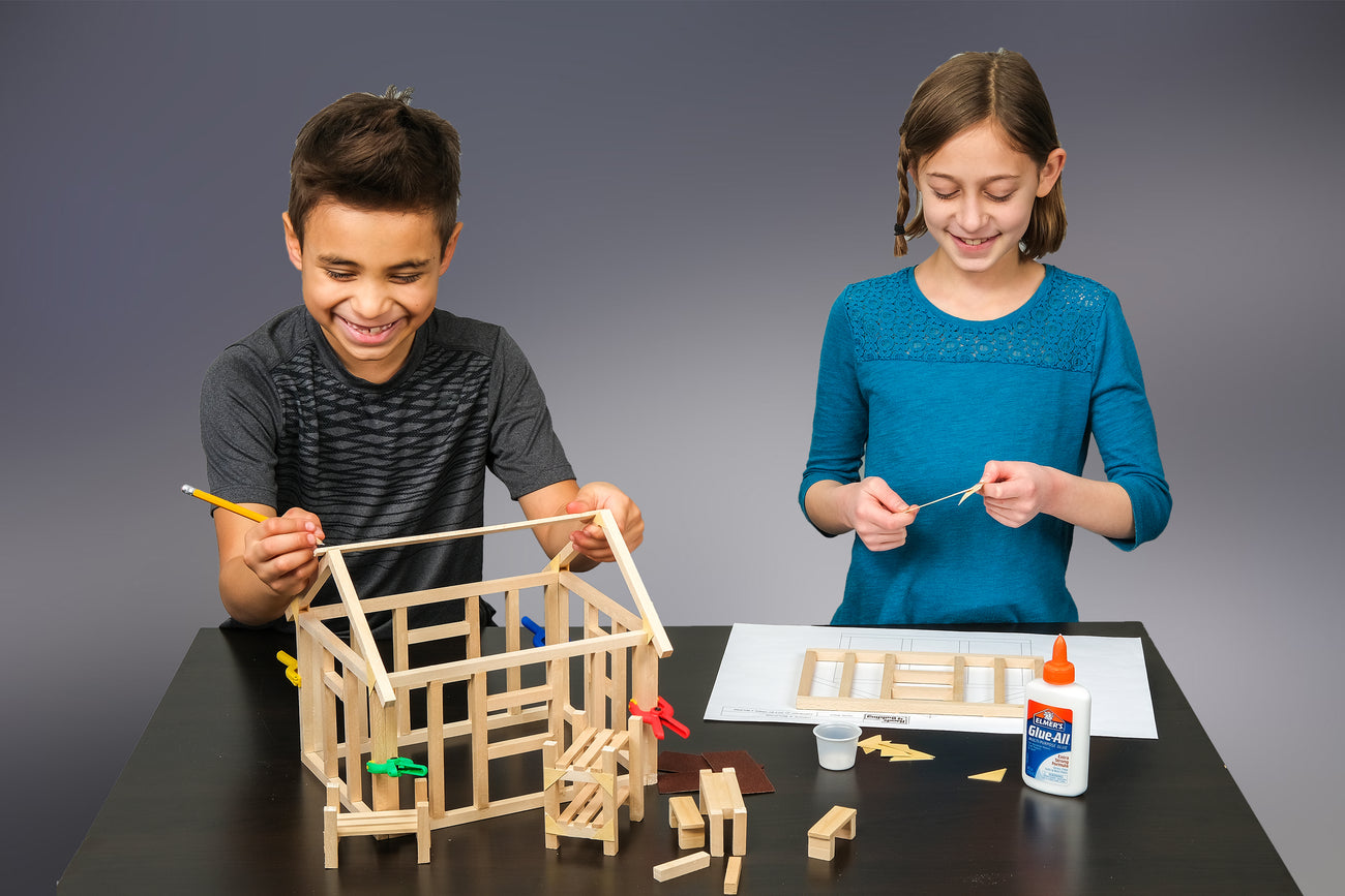 kids convert blueprints into structures