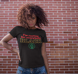 black woman wearing I'm rooting for everybody black' t shirt in Pan African colors