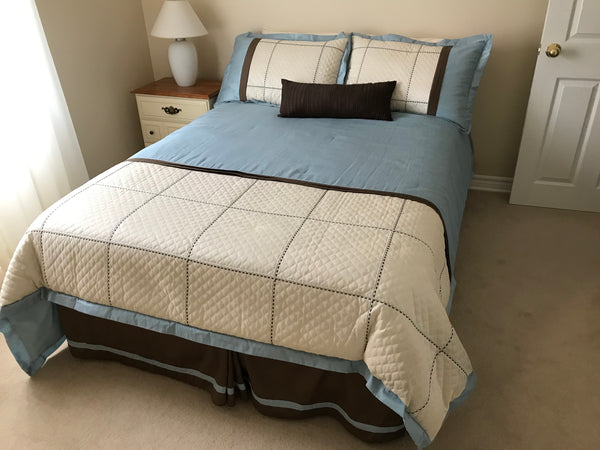 Double bed includes queen size comforter, bedskirt and pillow shams.