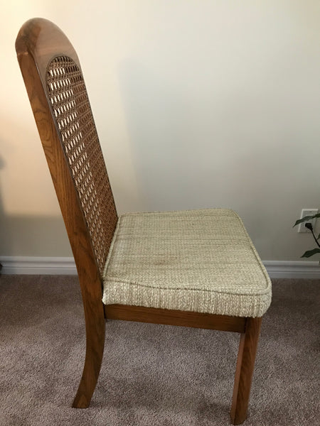 Dining chair, wood finish with woven cane inlay and padded cushion.