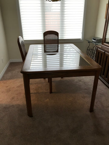 Dining room table, wood finish with glass and woven cane inlay.
