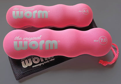 The Original Worm - portable massage roller in pink and black