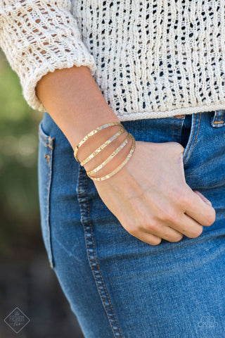 Get Used To GRIT - Gold Hammered Bracelet - Paparazzi Accessories