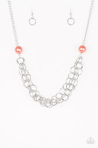 Two oversized coral pearls give way to dramatic silver chains, creating bold layers below the collar for a sassy look. Features an adjustable clasp closure.  Sold as one individual necklace. Includes one pair of matching earrings.