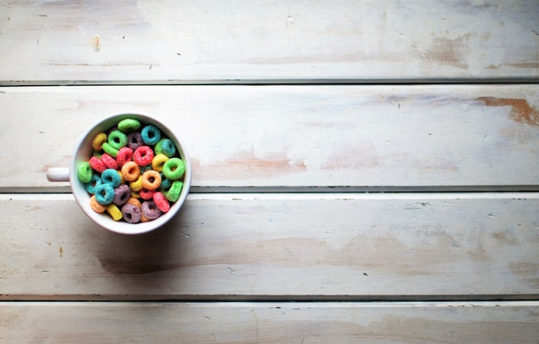 White ceramic bowl of Fruit Loops