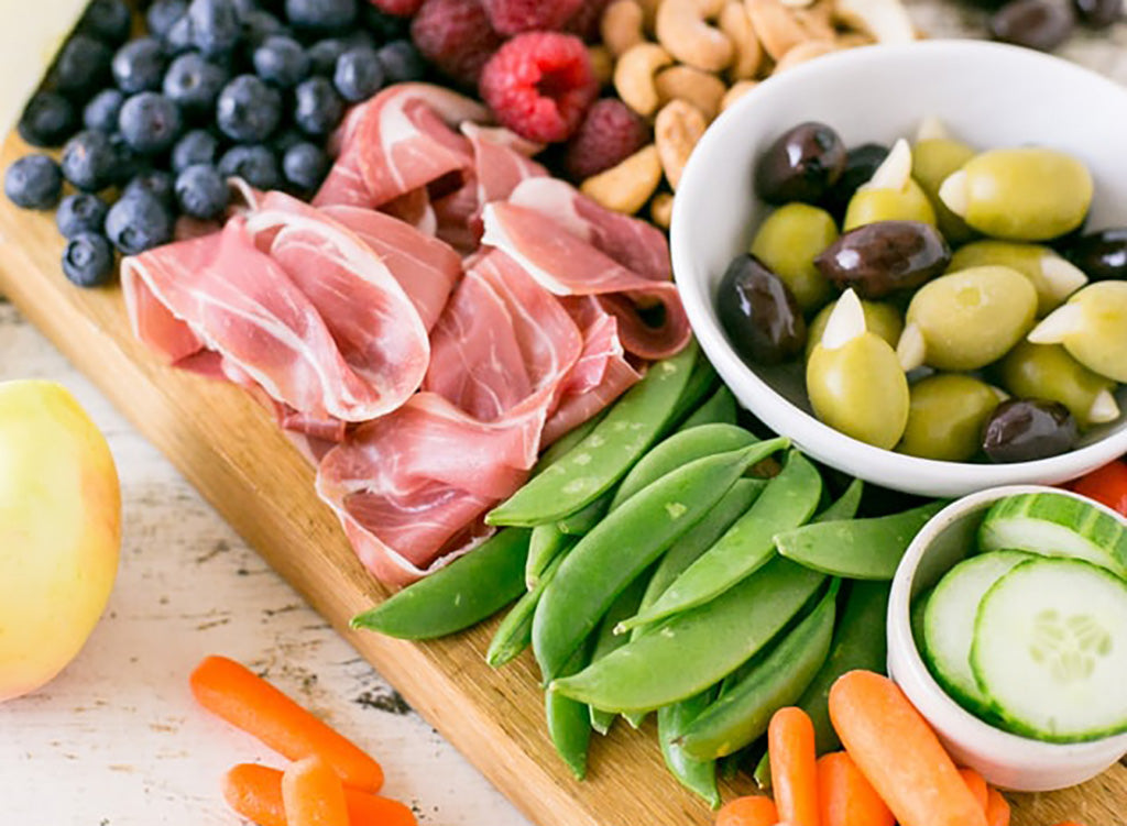 Easy Keto Snack: Charcuterie and Veggie spread on a wooden platter