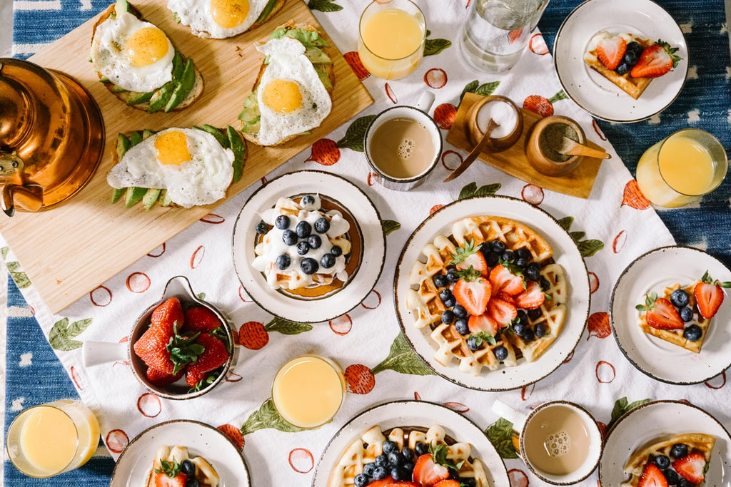 Second Breakfast: A beautiful table spread of waffles, eggs, fresh fruit, and more