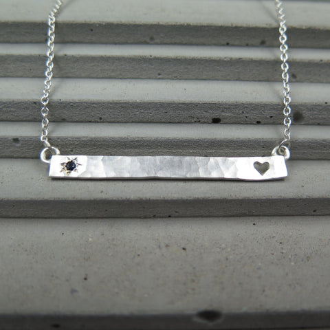 Sterling Silver pendant with heart cutout and australian sapphire.