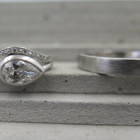 Pear diamond bezel set with milgrain edge engagment ring and wedding rings