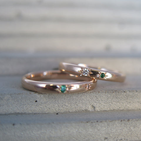 Emerald and diamond wedding rings in rose gold