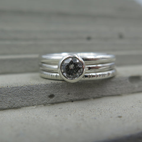 Sterling Silver stacking rings with salt and pepper diamond.