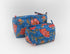 Set of two Cotton hand-block make up bag with two inside pockets in blue and pink floral print.