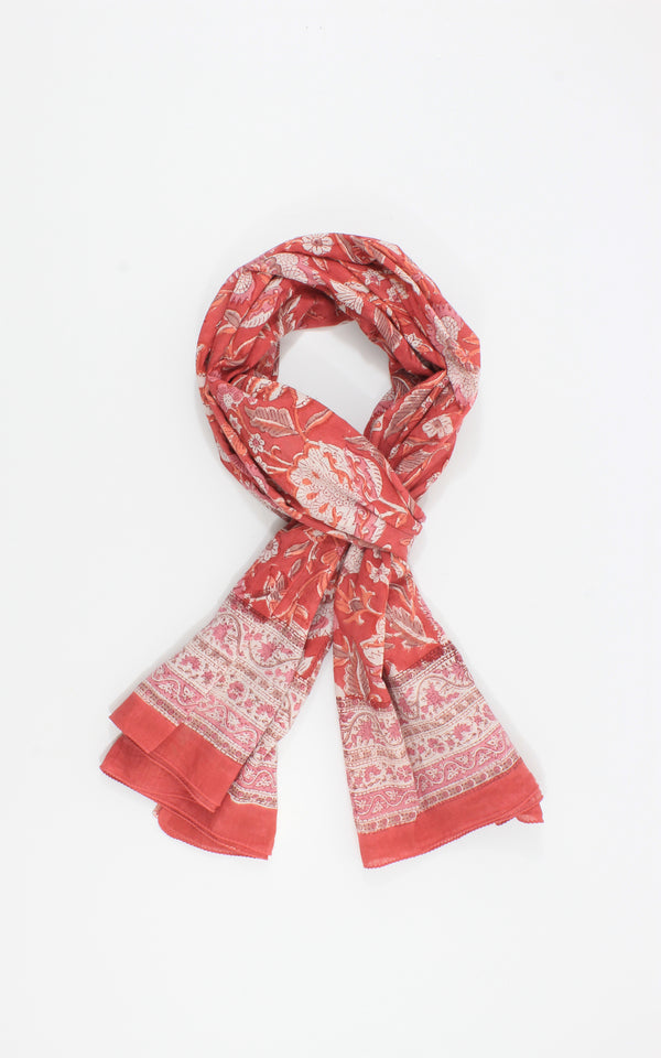 Beautiful hand block cotton scarf on a peach pink  base with white floral pattern.
