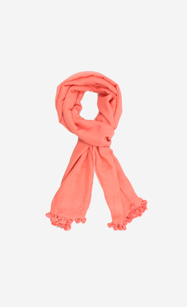 Soft handspun cotton scarf in peach pink with hand tied pompom tassels.