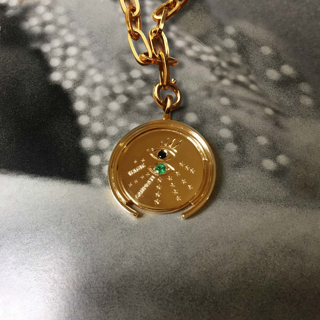 gold coin with emerald