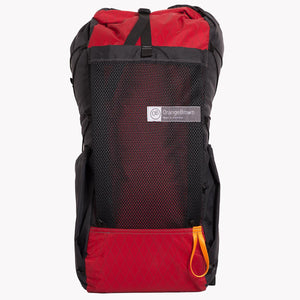 Front view of the OrangeBrown OB36 36 L volume backpack. Australian made backpack with roll top, large mesh pocket and two side pockets. Here shown in red and black.