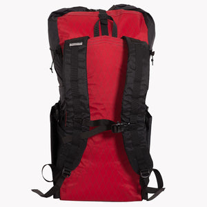 OrangeBrown backpack OB 36 made from X-Pac fabric. Showing back of pack with wide and padded shoulder straps and sternum strap including emergency whistle. Colour is red and black.