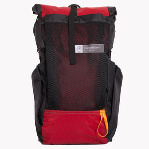 Australian made backpack OB36 by OrangeBrown. With roll top, large mesh pocket and two fabric side pockets. Here shown in red and black.