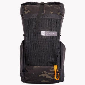 X-Pac backpack made in Australia by OrangeBrown. With roll top, large mesh pocket and two fabric side pockets. Here shown in multicam black.