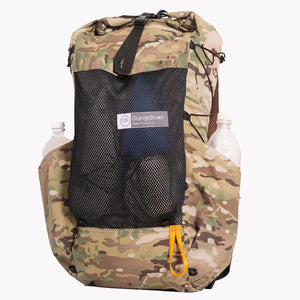Medium sized backpack in multicam camouflage.  The two side pockets carry a 1 L bottle each. The front mesh pocket is packet with wind jacket and small cubes tarp. Side compression cord with a Line Loc 3 and an orange webbing loop to fix the trekking poles. Made in Australia from X-Pac fabric.