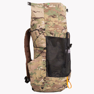 Side view of a medium sized backpack made from X-Pac multicam fabric.  The roll top wide open showing the full length of the pack.  Made in Australia from X-Pac fabric.