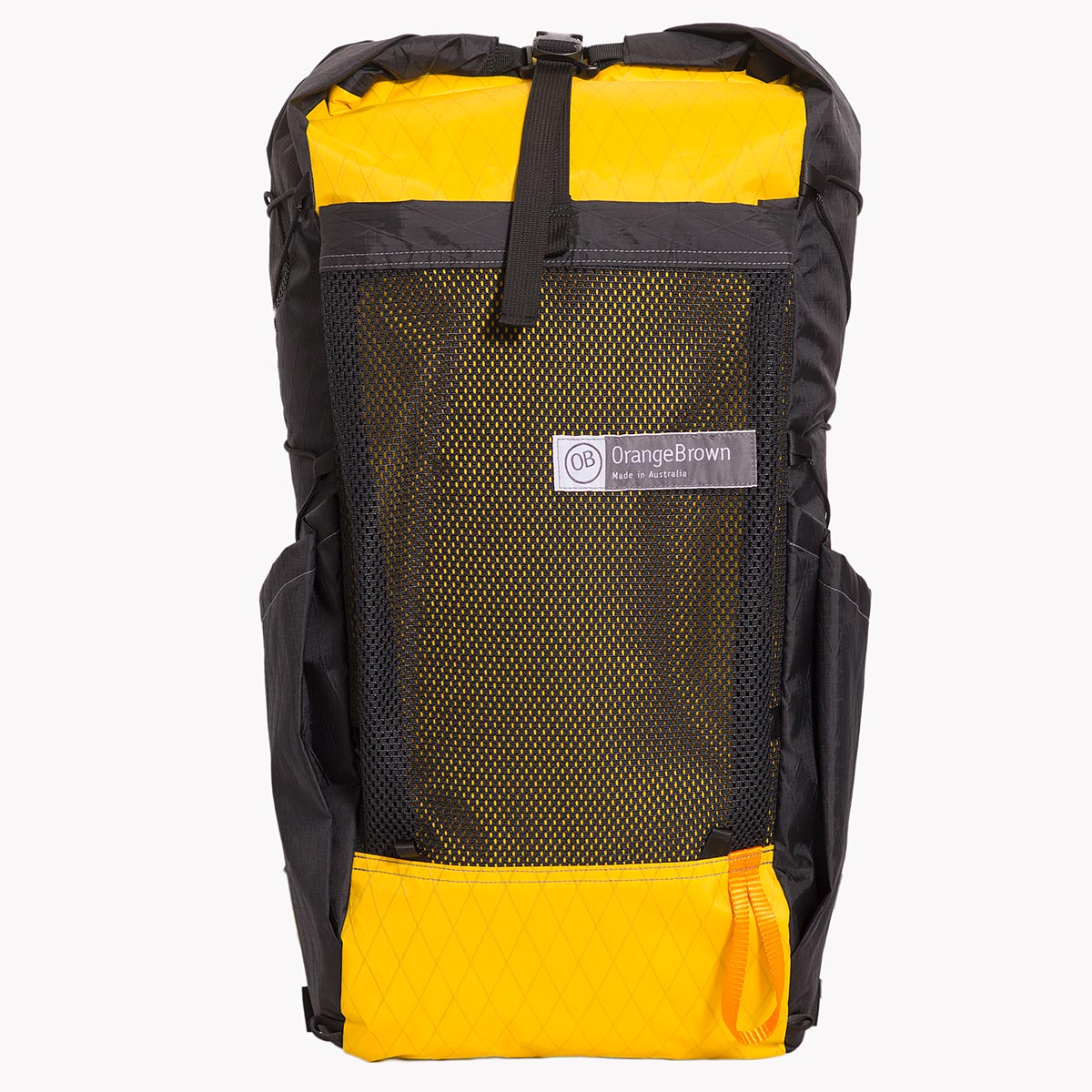 Medium sized backpack in yellow and black X-Pac fabric. The pack has a volume of 36 L including two side pockets and a front mesh pocket. Side compression cord with a Line Loc 3 and an orange webbing loop to fix the trekking poles. Made in Australia.
