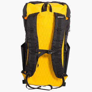 View of the shoulder straps with a sternum strap of a backpack. The back panel is yellow and the sides are black, both made from X-Pac fabric in Australia.