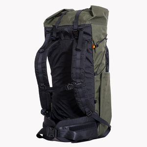 Sideview of the OrangeBrown OB 45 backpack showing padded shoulder straps and hip belt. Also visible is the side compression cord including the LineLoc 3.