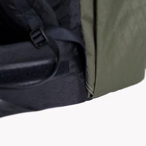 OrangeBrown backpacks have a hole at the bottom of the side pockets for draining water in the rain.