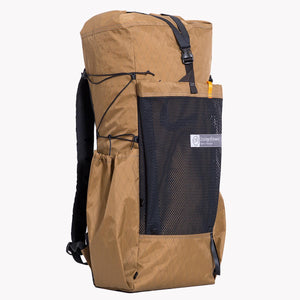 Hiking backpack made from X-Pac fabric in colour coyote. Featuring three external pockets, roll top with Y-strap closure, padded hip belt and load lifters.