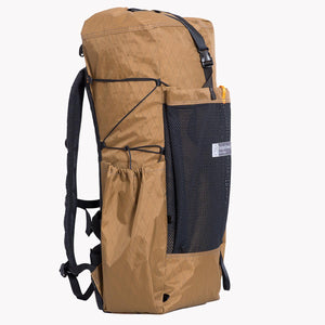 Extended pocket on right side of this hiking backpack. A LineLoc 3 and 2.5mm cord is used for the compression of the OrangeBrown OB 45 backpack.