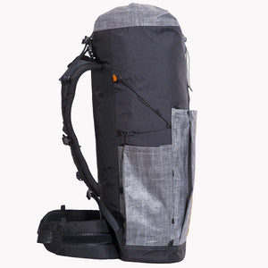 Sideview of OB 55 hiking backpack. The pockets are made from Lite Skin 07 and the main body and other parts are made from X-Pac fabric VX07 and VX21. Sidecompression with 2.5mm cord and LineLoc-3.