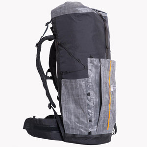 Sideview of OB 55 hiking backpack. The pockets are made from Lite Skin 07 and the main body and other parts are made from X-Pac fabric VX07 and VX21. The hip belt is 12cm wide and uses 38mm webbing for a good fit.