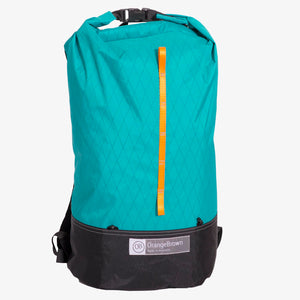 X-Pac fabric day pack with roll closure in teal-black. Made in Australia.