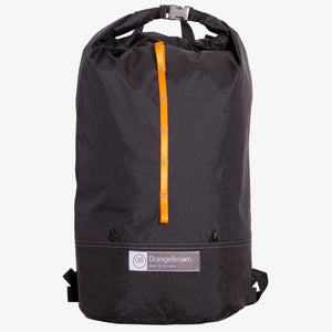 Ultralight day pack made from X-Pac fabric with roll closure in colour black.