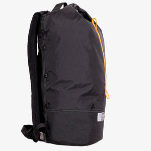 Side view of ultralight day pack hand made from X-Pac fabric with roll closure in colour black. Made in Australia.