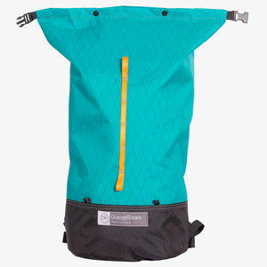 Frontal view oDay pack with open roll top in teal-black. Made in Australia.