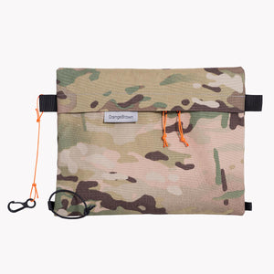 Camouflage sternum strap bag made from black X-Pac X-33 fabric with Cordura® face fabric.