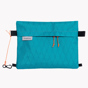 Sternum strap bag made from teal X-Pac VX21 fabric. Slides over the sternum strap of a backpack.
