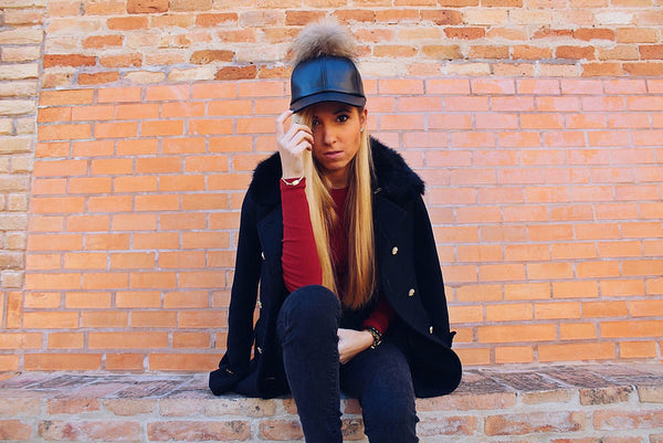 See how Blogger Elena Cano style our Black Leather Fur Pom Cap!