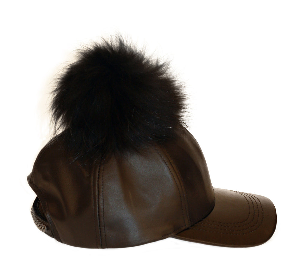 Black leather cap with black fur pom
