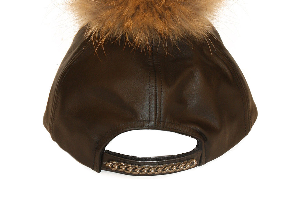 Black leather cap with brown fur pom