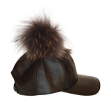 Black leather cap with grey fur pom