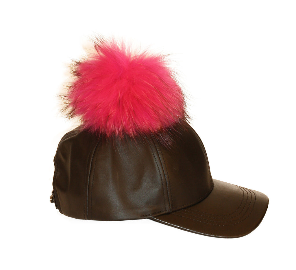 Black leather cap with pink fur pom
