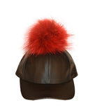 Black leather cap with red fur pom